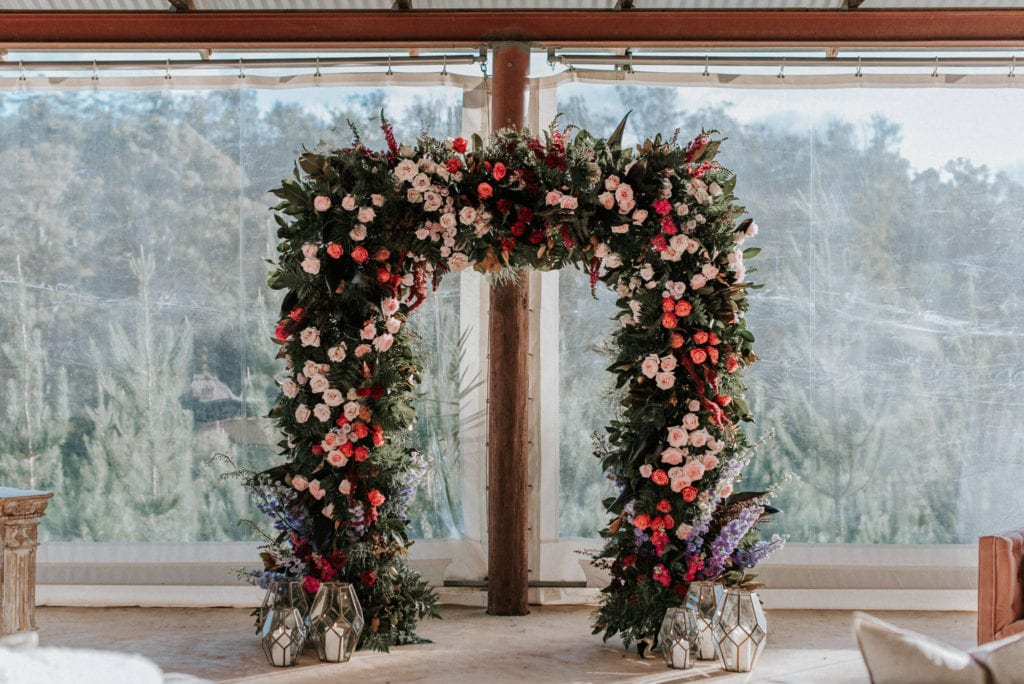colourful and bright wedding flower arch in margaret river